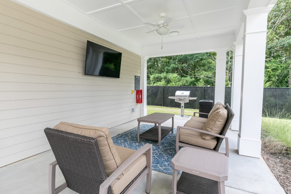 Outdoor living room with tv at The Station at River Crossing in Macon, Georgia