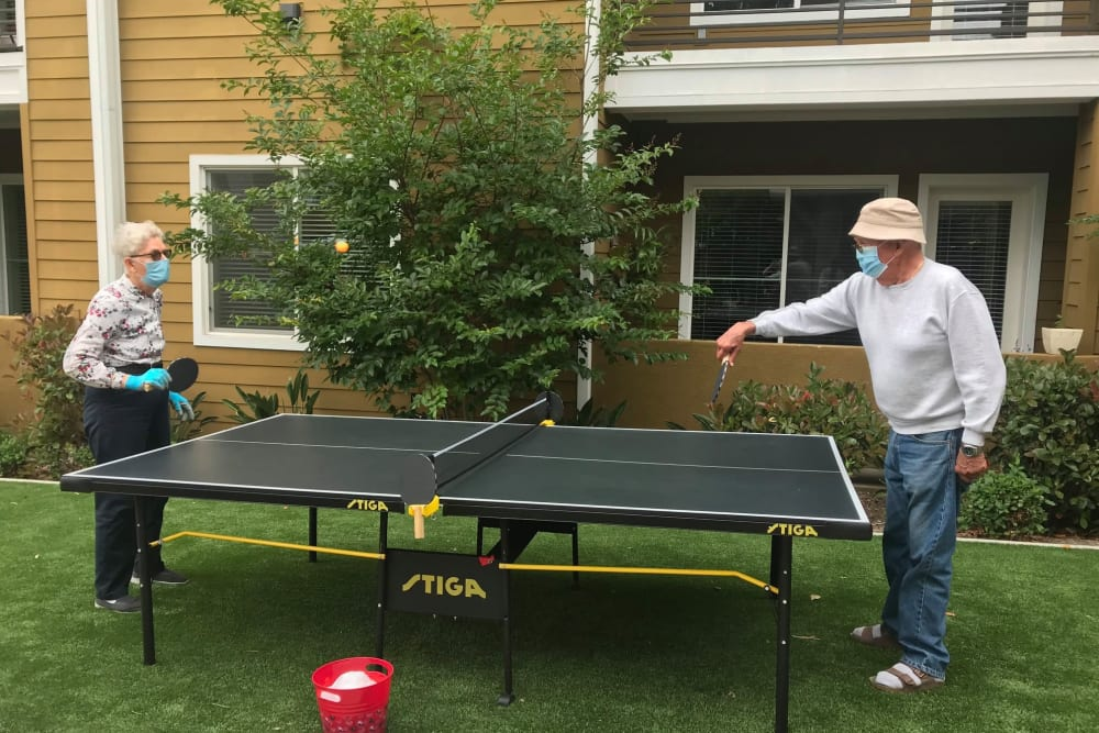 Residents playing ping-pong in masks at Clearwater Living