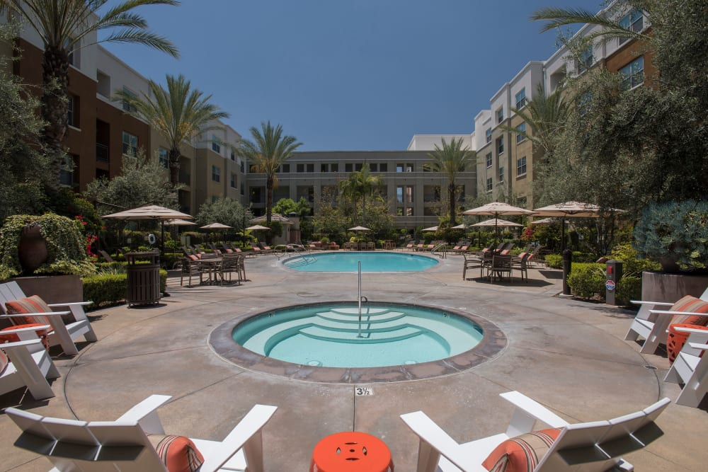 Hot tub surrounded by lounge chairs at Paragon at Old Town in Monrovia, California