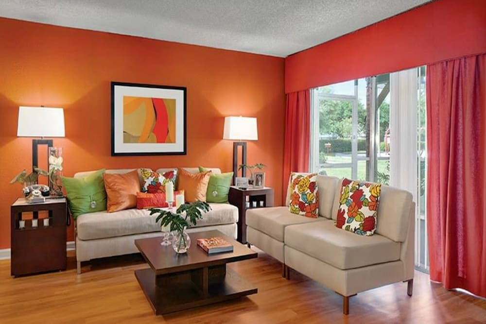 Living room with sectional couch at Signal Pointe Apartment Homes in Winter Park, Florida