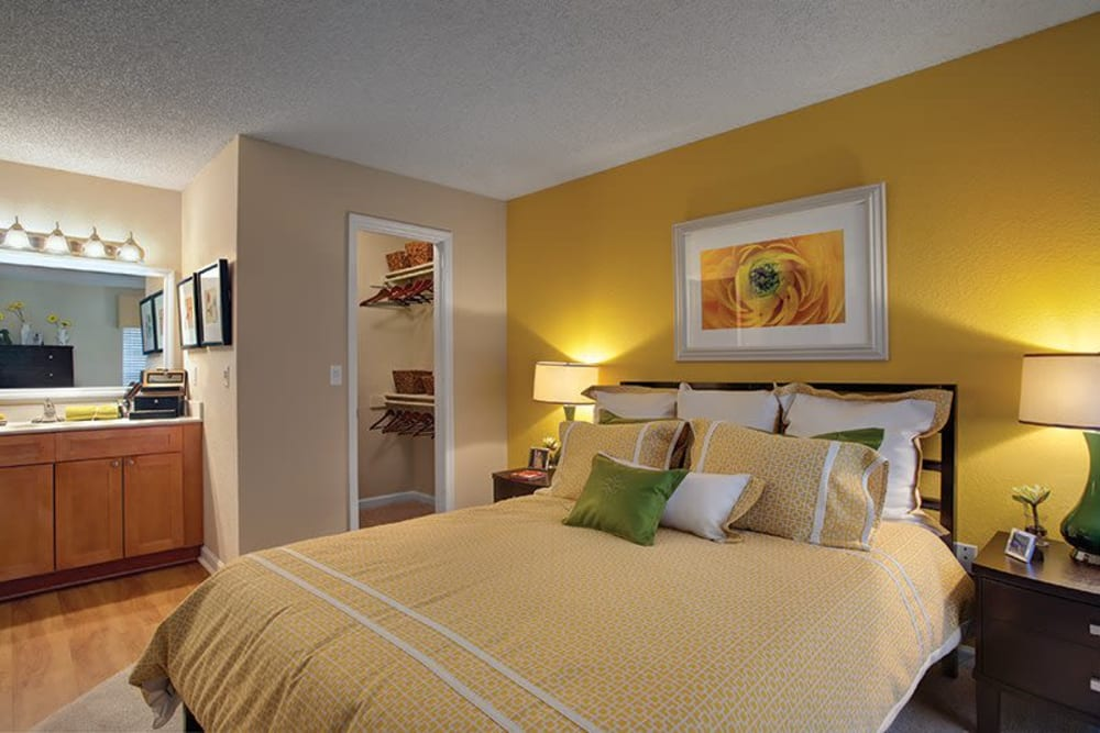 Well decorated model bedroom at Signal Pointe Apartment Homes in Winter Park, Florida