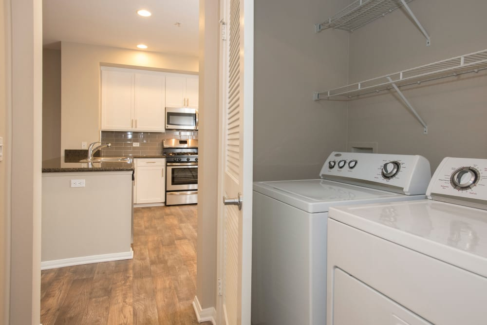 Spacious laundry room with a washer and dryer at Paragon at Old Town in Monrovia, California