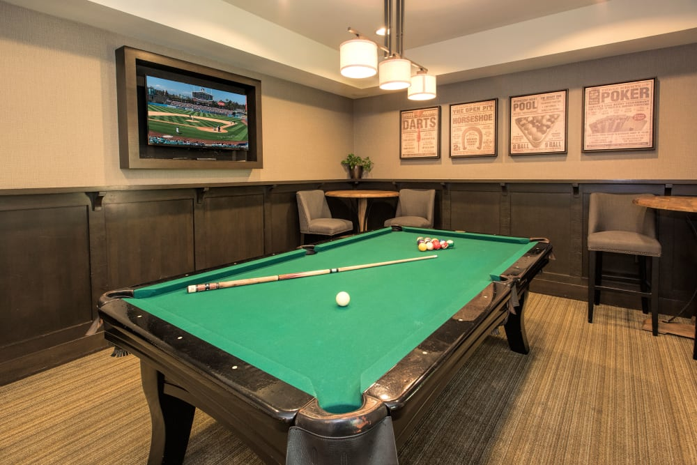 Billiards room with table and chairs and flat-screen TV at Paragon at Old Town in Monrovia, California