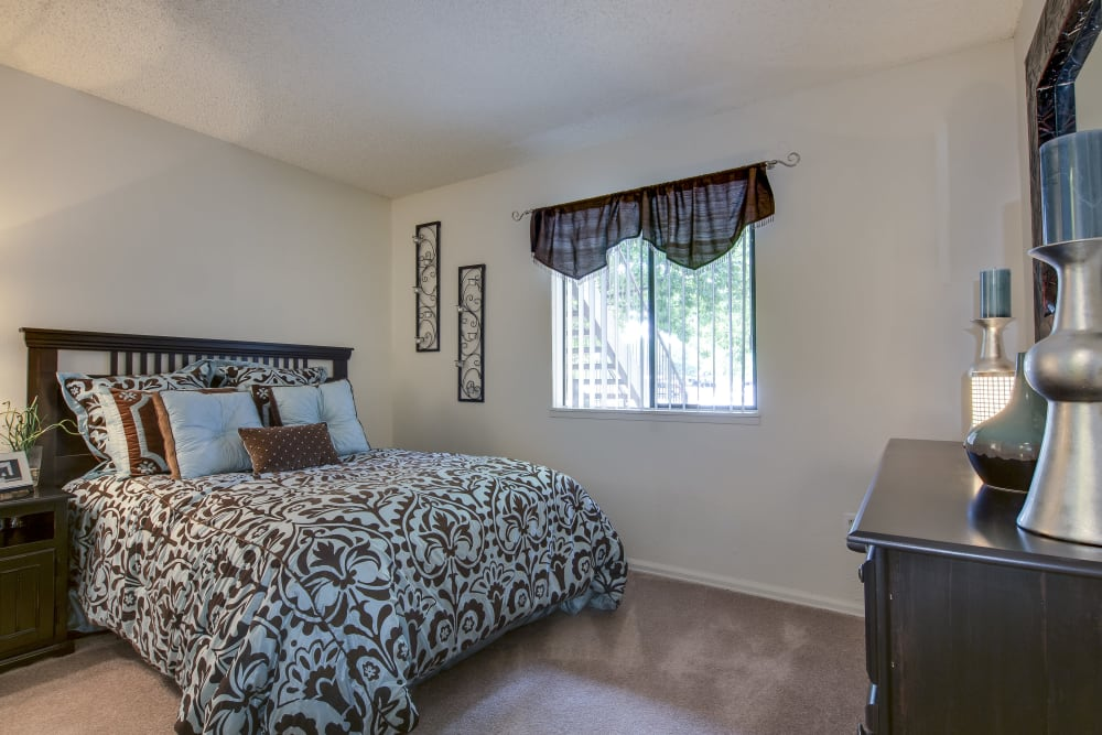 Well lit model bedroom at Santana Ridge in Denver, Colorado