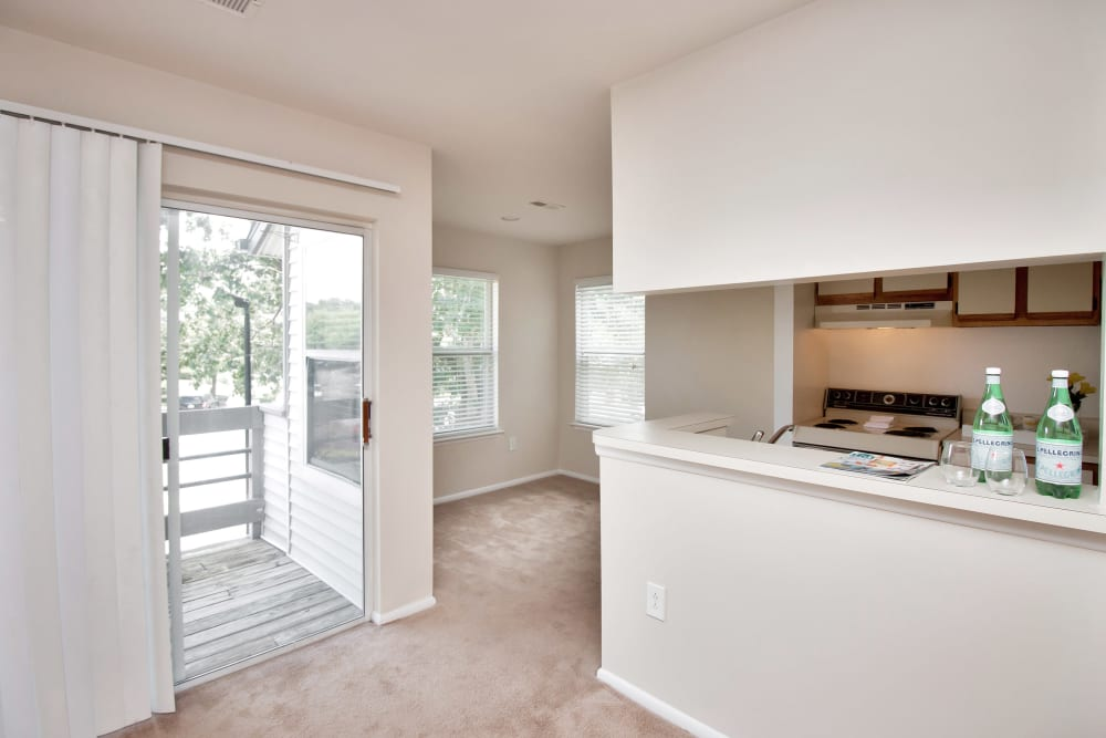 View of kitchen bar and front entry at Runaway Bay Apartments in Virginia Beach, Virginia