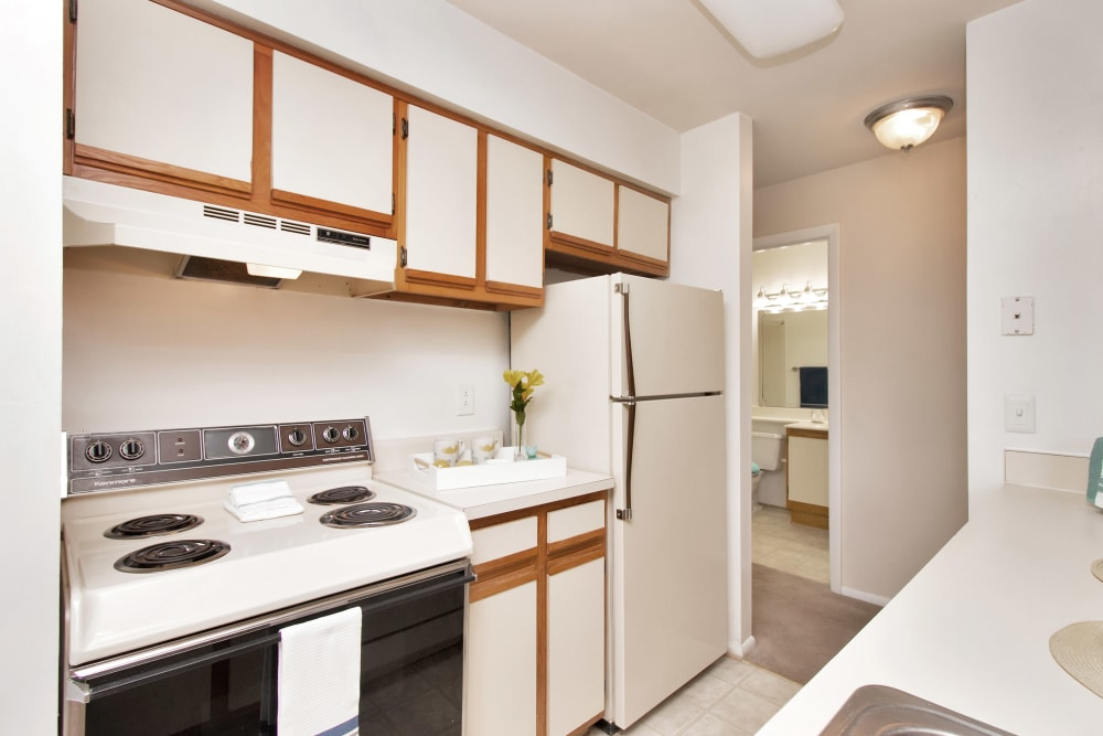 Modern kitchen with beautiful white wood cabinets at Runaway Bay Apartments in Virginia Beach, Virginia