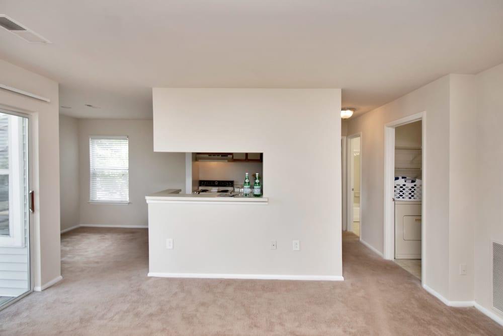 Kitchen overlooking living room at Runaway Bay Apartments in Virginia Beach, Virginia