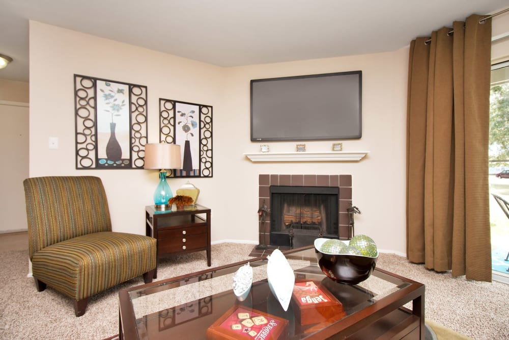 Model living room with fireplace at Runaway Bay Apartments in Virginia Beach, Virginia