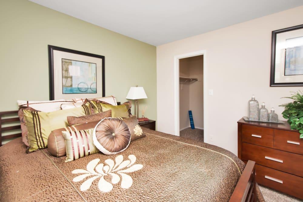 Well decorated model bedroom at Runaway Bay Apartments in Virginia Beach, Virginia