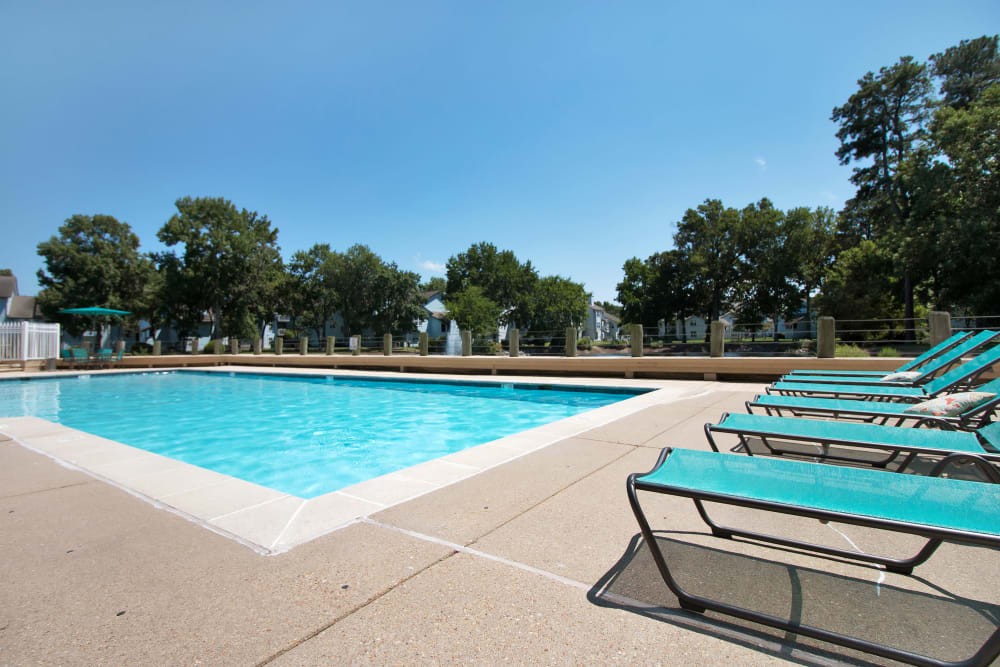 Lounge chairs poolside at Runaway Bay Apartments in Virginia Beach, Virginia