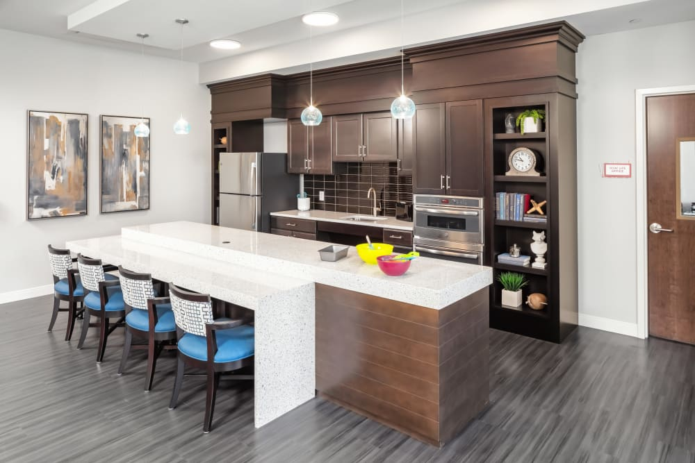 Upscale cafe kitchen with a serving bar and hardwood floors at Aspired Living of La Grange in La Grange, Illinois