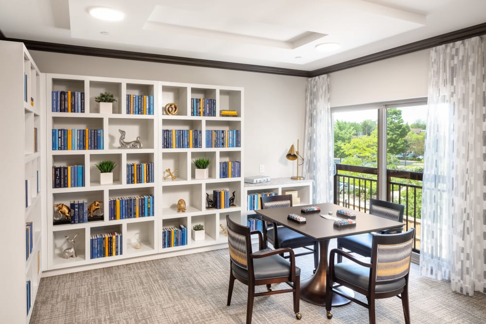 Quiet reading room with several bookshelves at Aspired Living of La Grange in La Grange, Illinois