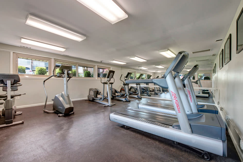 Exercise equipment in the fitness room at Cinnamon Run at Peppertree Farm in Silver Spring, Maryland