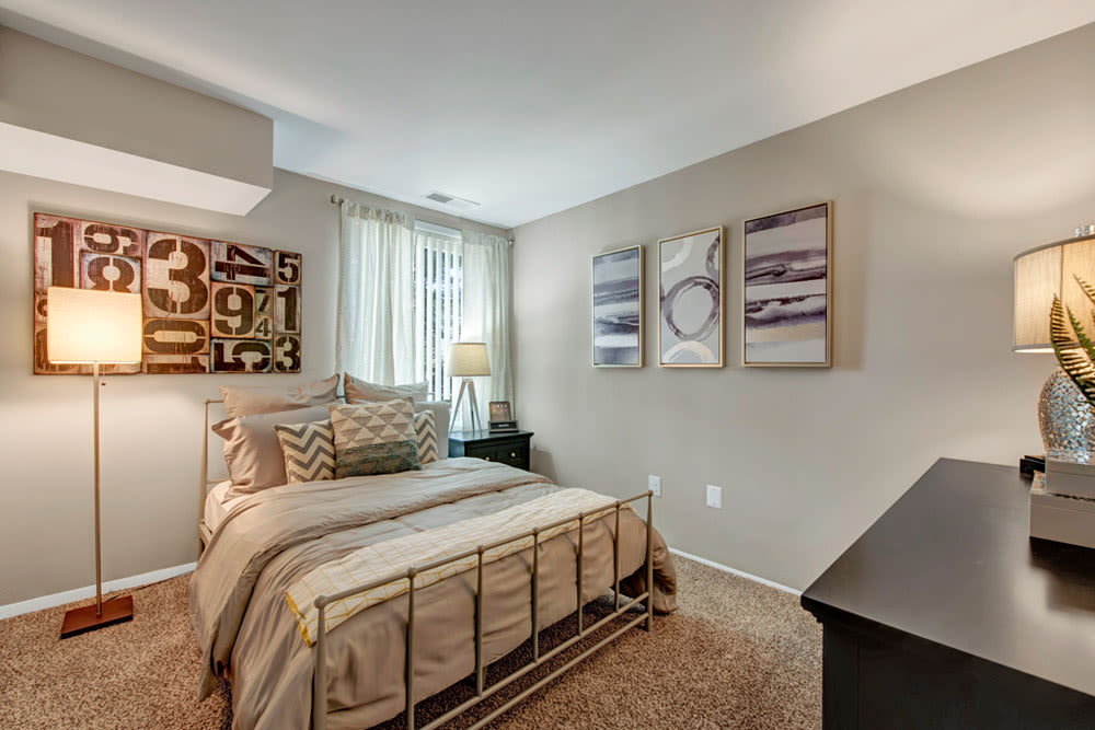 Comfortable bedroom with window in the corner In an apartment located in Silver Spring, Maryland