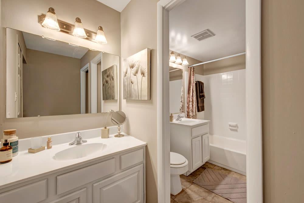 Main bedroom bathroom  at Cinnamon Run at Peppertree Farm in Silver Spring, Maryland features vanity with a sink in the dressing area