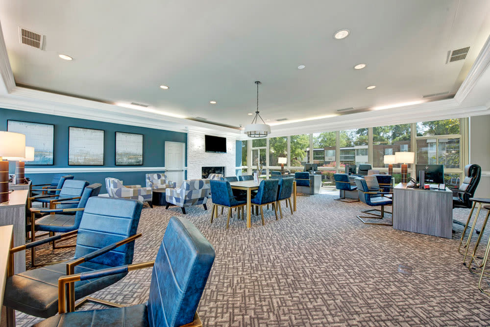 Leasing office interior with desks and sitting areas at Cinnamon Run at Peppertree Farm in Silver Spring, Maryland