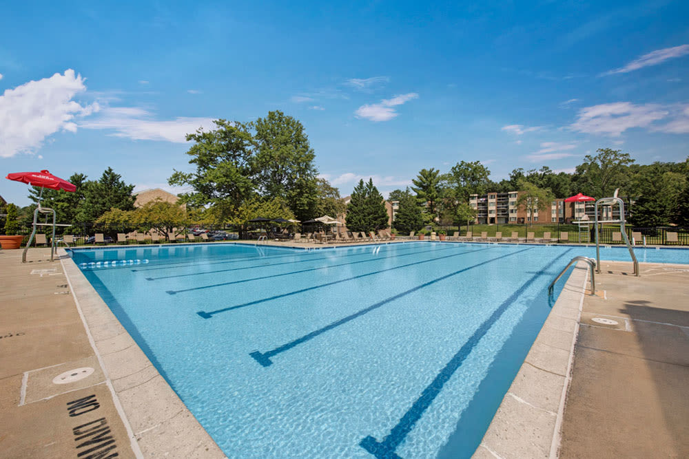 Large outdoor community swimming pool is featured at Cinnamon Run at Peppertree Farm in Silver Spring, Maryland