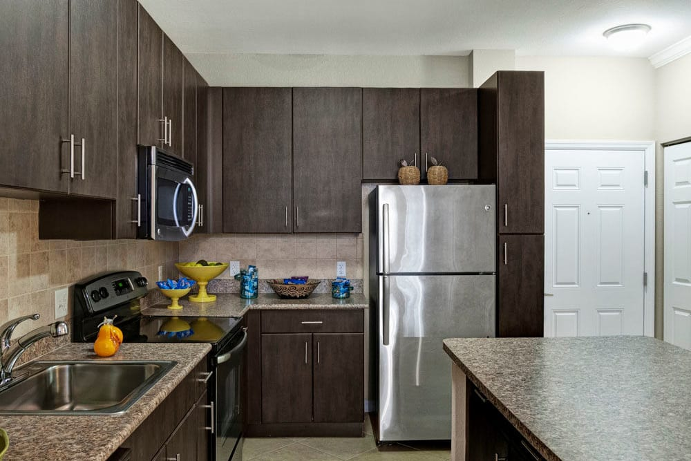 This apartment at City Center on 7th Apartment Homes in Pembroke Pines, Florida features stainless steel appliances and ample counter space