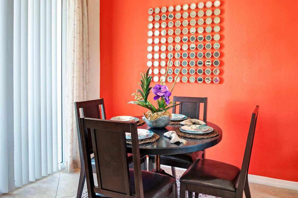 Brightly painted wall in dining room area in an apartment at City Center on 7th Apartment Homes in Pembroke Pines, Florida