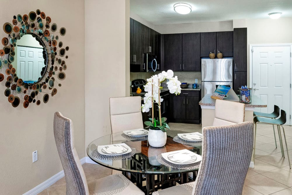 Dining table area off of kitchen In an apartment at City Center on 7th Apartment Homes in Pembroke Pines, Florida