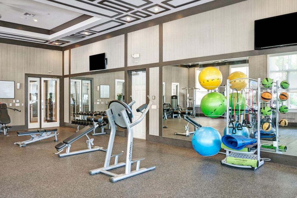 High ceilings are a feature of this fitness center at City Center on 7th Apartment Homes in Pembroke Pines, Florida