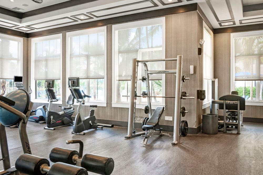Workout equipment in the fitness center at City Center on 7th Apartment Homes in Pembroke Pines, Florida