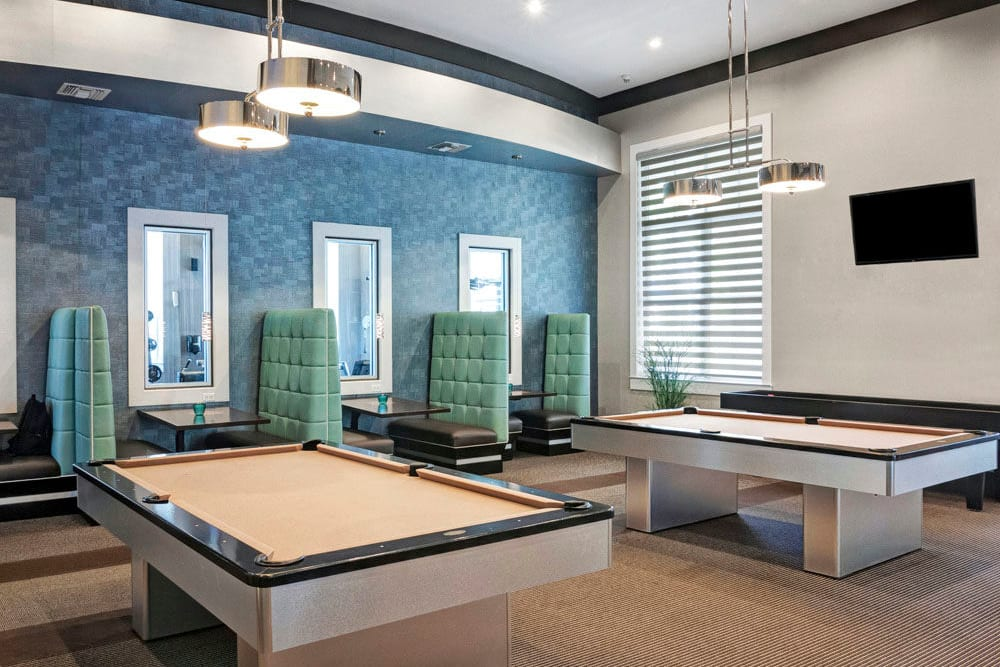 Billiards table and shuffleboard and clubhouse at City Center on 7th Apartment Homes in Pembroke Pines, Florida