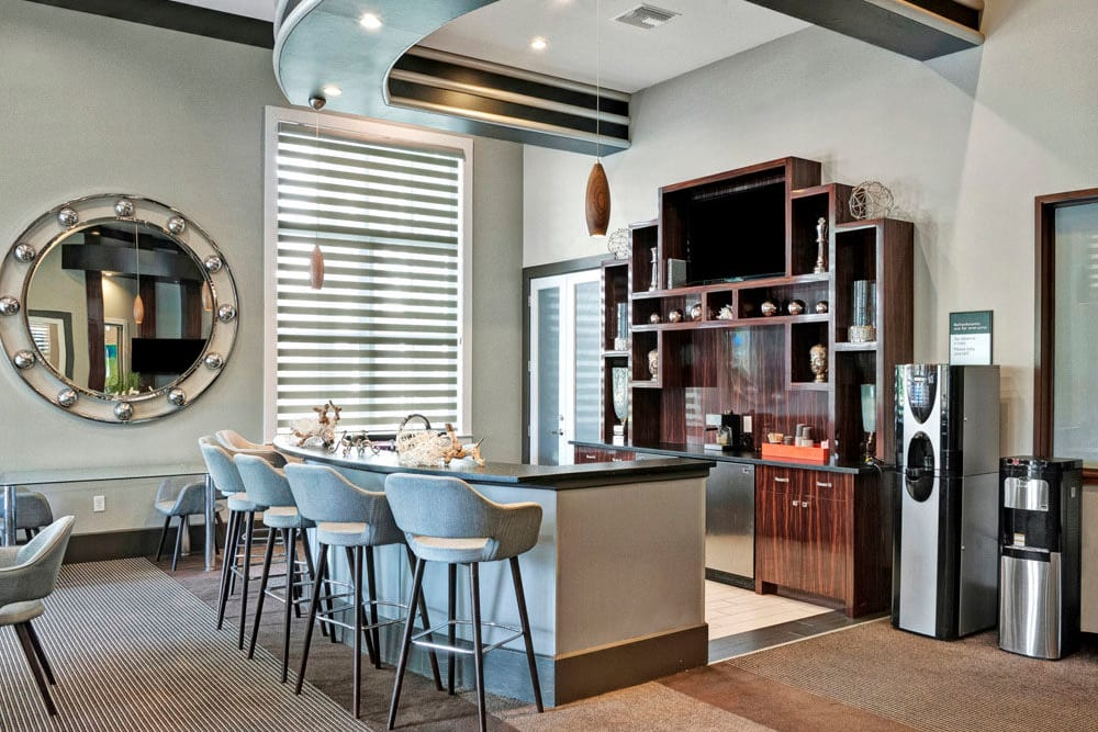 Finally decorated clubhouse interior featuring high ceilings at City Center on 7th Apartment Homes in Pembroke Pines, Florida