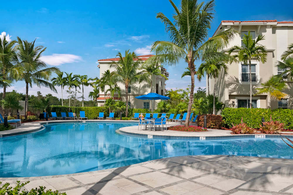 Poolside community space at City Center on 7th Apartment Homes in Pembroke Pines, Florida