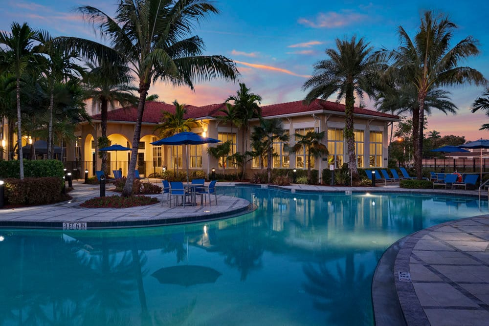 Sunset clouds over community pool and clubhouse at City Center on 7th Apartment Homes in Pembroke Pines, Florida