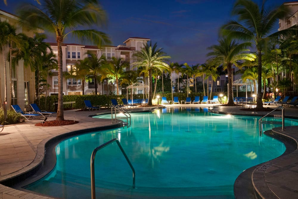 Pool at City Center on 7th Apartment Homes in Pembroke Pines, Florida lit up at night