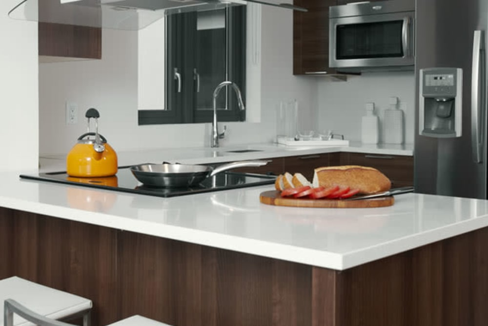 Kitchen with orange accents at Monarch at Ridge Hill in Yonkers, New York