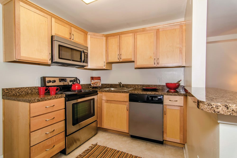 Kitchen with stainless steel appliances at Ridley Brook Apartments in Folsom, Pennsylvania