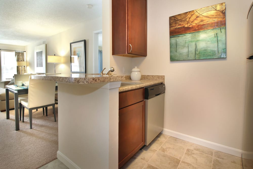 View towards dining area from kitchen in an apartment at The Commons At Haynes Farm in Shrewsbury, Massachusetts