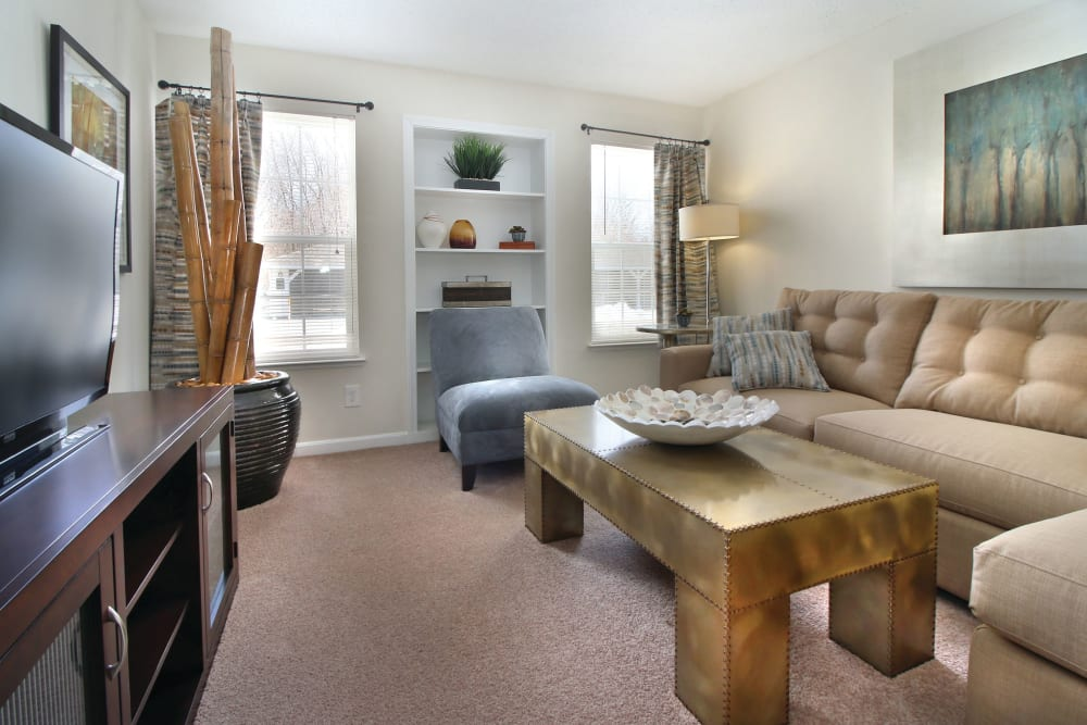 Living room with couch seating and coffee table in an apartment at The Commons At Haynes Farm in Shrewsbury, Massachusetts