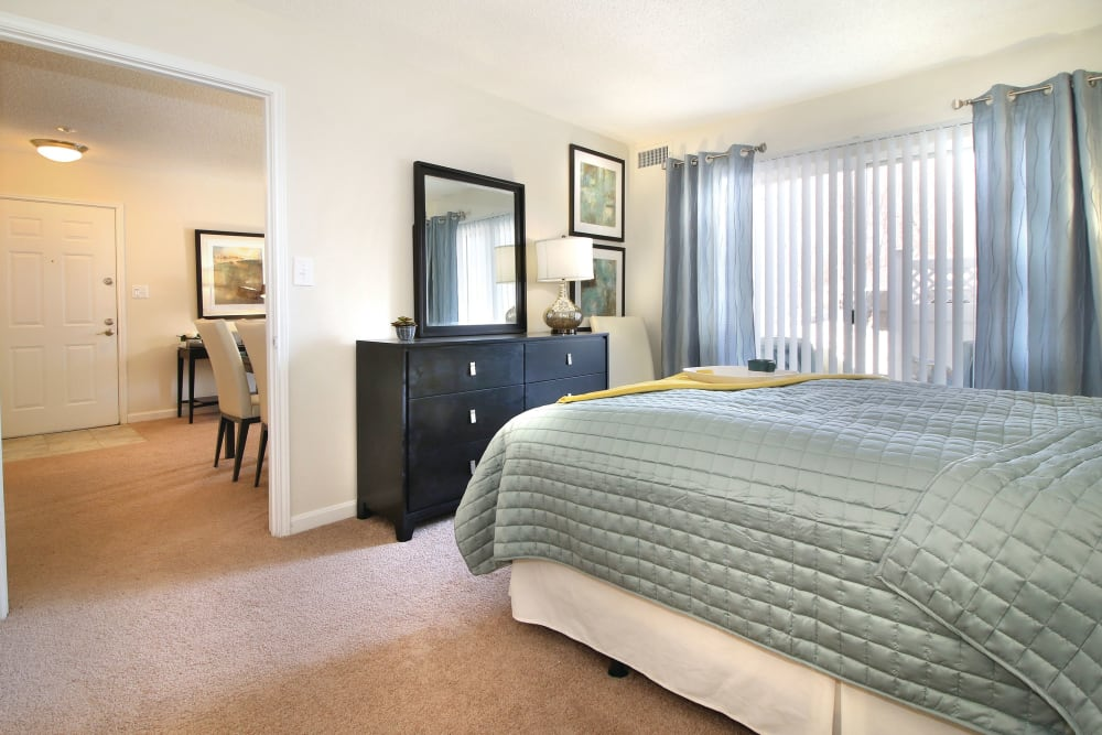 Our spacious Apartments in Shrewsbury, Massachusetts showcase a bedroom with large windows for ample natural light
