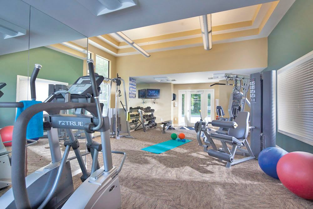Spacious fitness center with modern equipment at The Commons At Haynes Farm in Shrewsbury, Massachusetts
