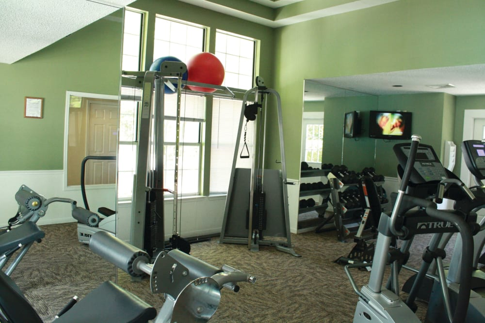 Variety of workout equipment in the fitness center at The Commons At Haynes Farm in Shrewsbury, Massachusetts