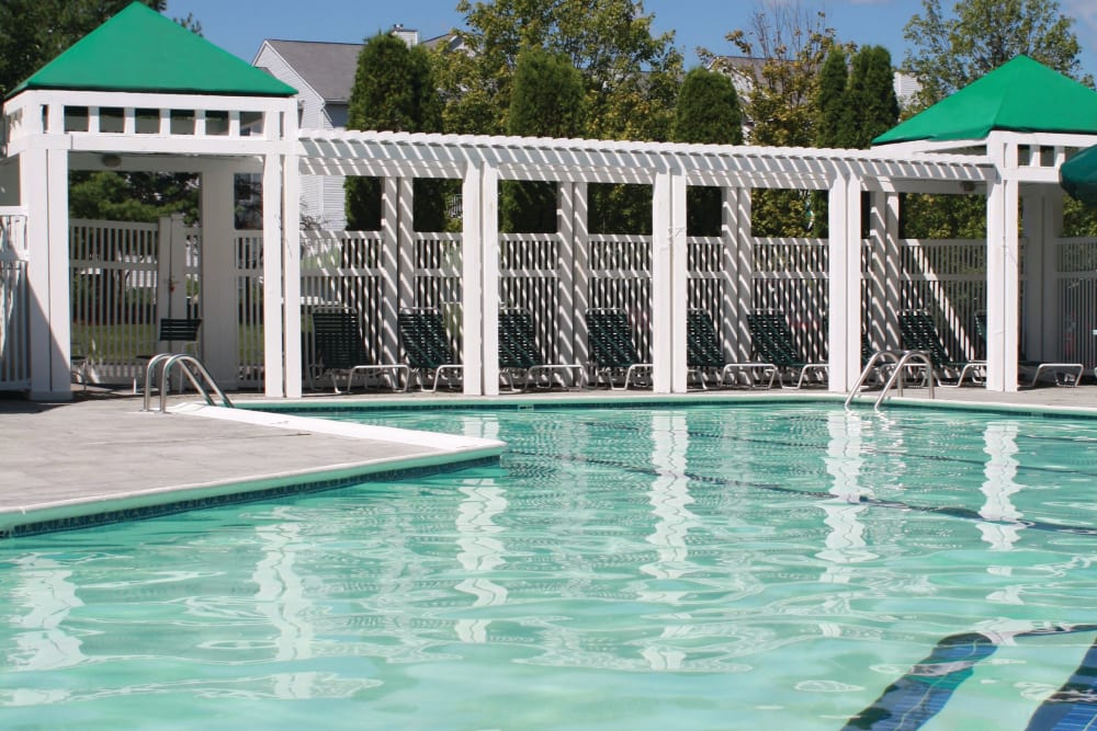 Community pool at The Commons At Haynes Farm in Shrewsbury, Massachusetts with shade gazebo for lounge chairs