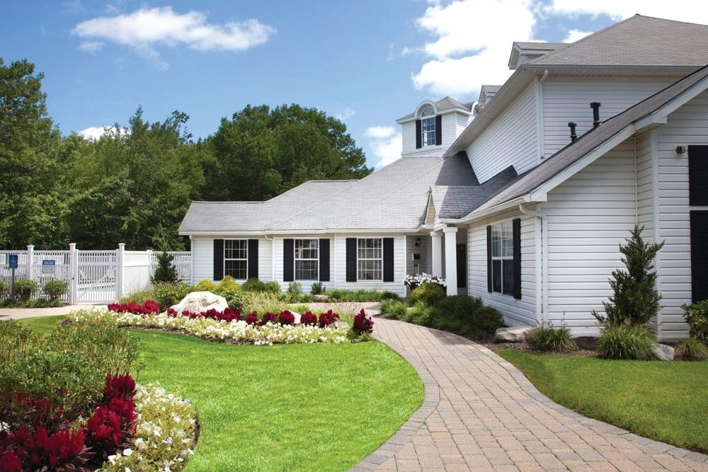 Well-maintained landscaping outside of leasing office at The Commons At Haynes Farm in Shrewsbury, Massachusetts