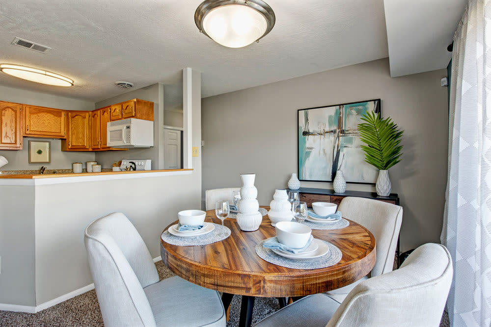 Dining room table with kitchen in the background at Country Village Apartments in Bel Air, Maryland