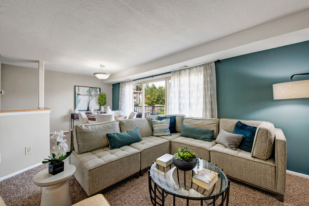 Living room with coffee table and couch seating in an apartment at Country Village Apartments in Bel Air, Maryland