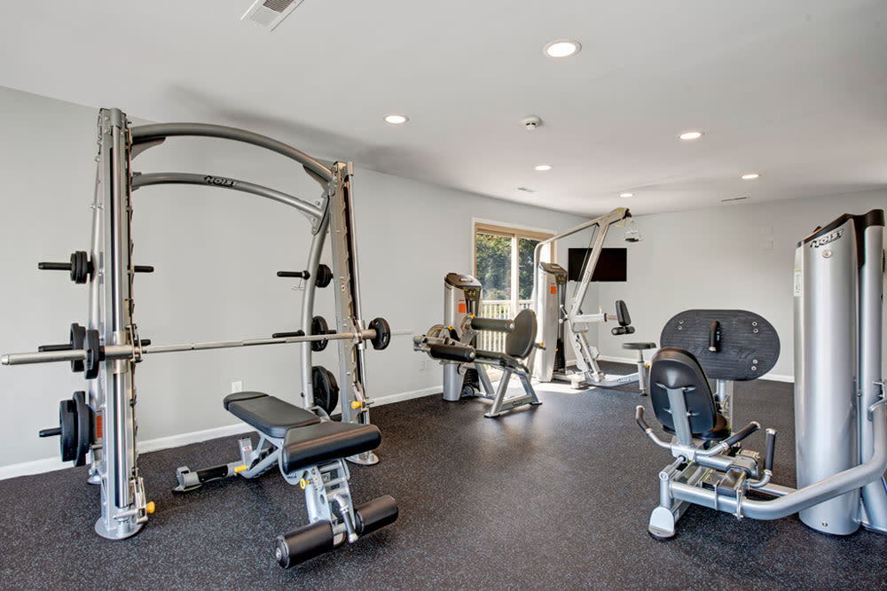 Free weights and other workout equipment at Country Village Apartments in Bel Air, Maryland