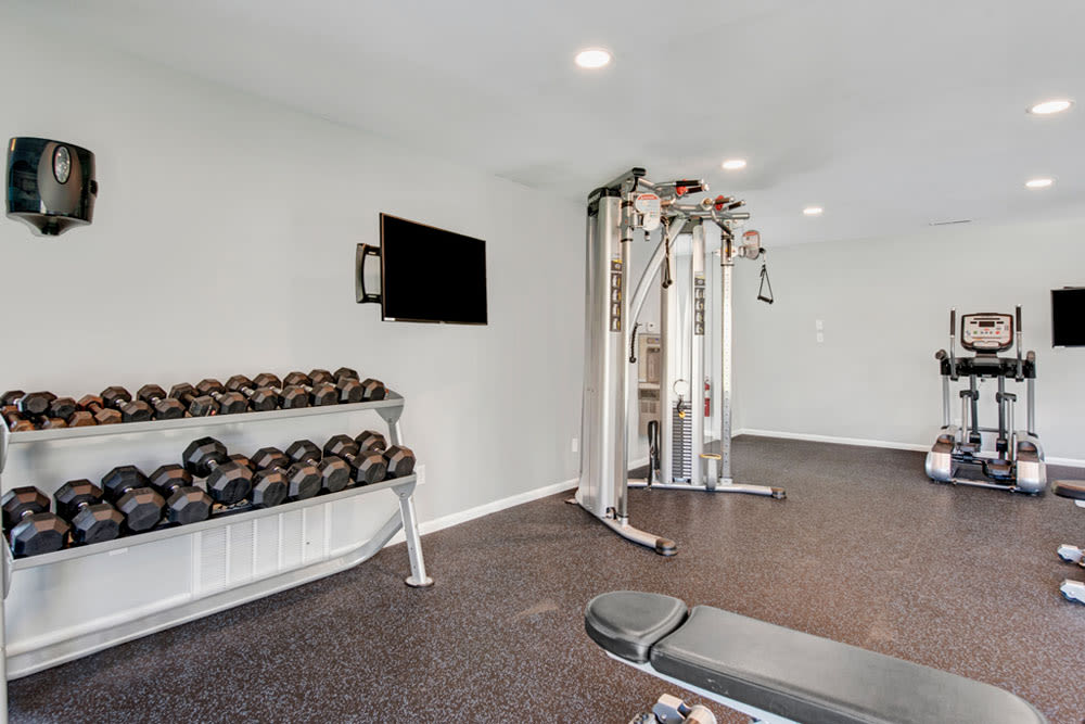 Exercise equipment in the fitness center at Country Village Apartments in Bel Air, Maryland