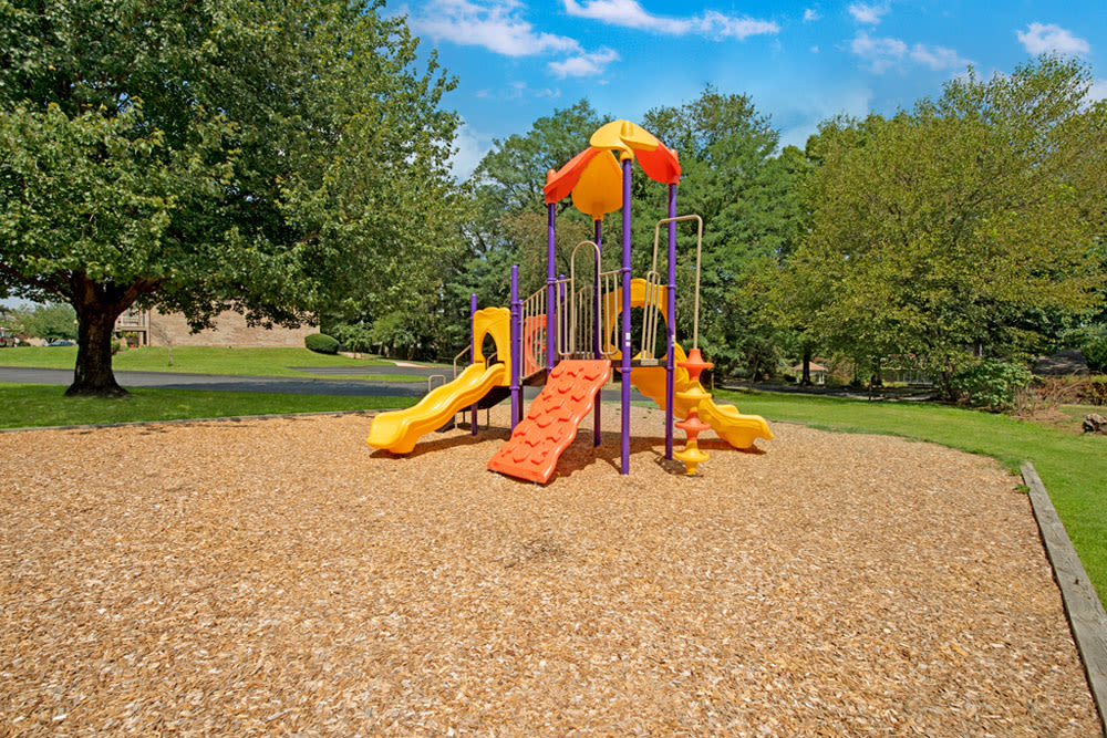 Play ground equipment with bark chip base at Country Village Apartments in Bel Air, Maryland