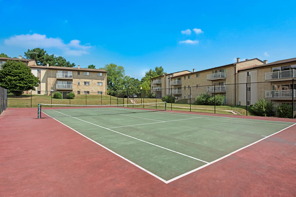 Tennis courts with buildings in the background at Country Village Apartments in Bel Air, Maryland