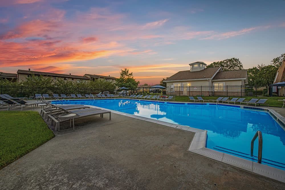 Orange clouds at sunset highlight the sky over the Swimming Pool at Country Village Apartments in Bel Air, Maryland