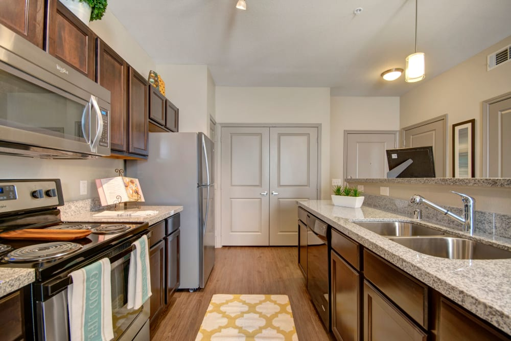 Kitchen with modern amenities and ample countertop space in an apartment at Creekside South in Wylie, Texas