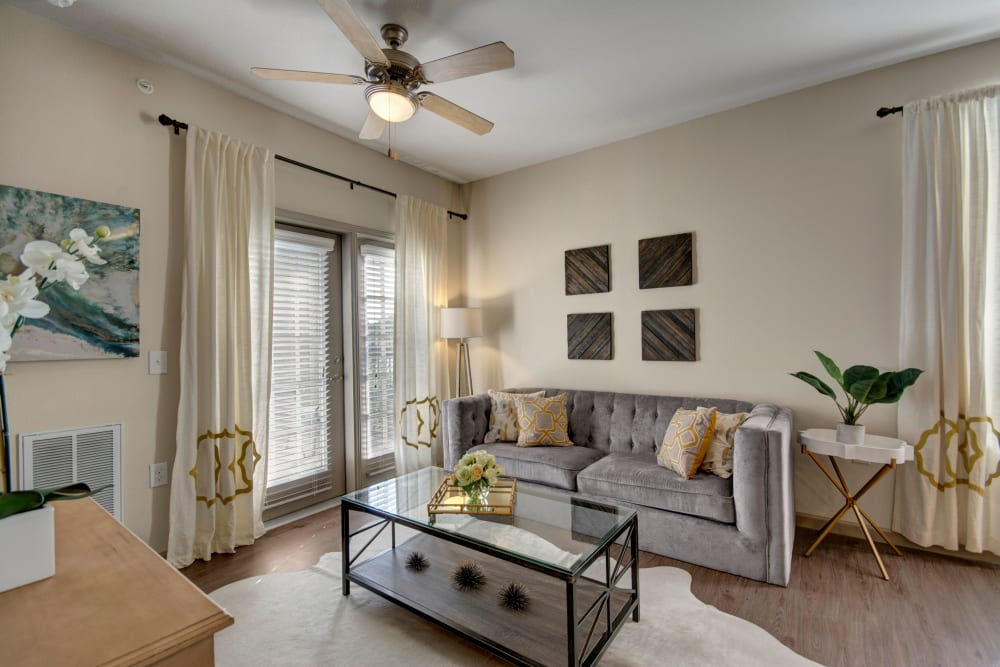 Living room with large windows for ample natural light In an apartment at Creekside South in Wylie, Texas