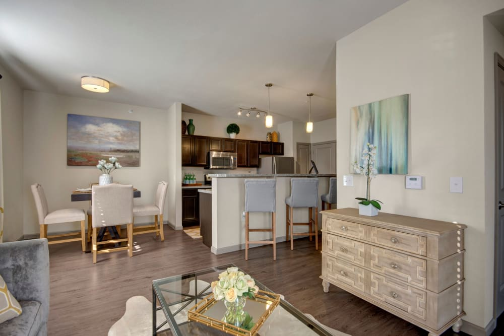 Well decorated living room interior with view towards kitchen and dining space at Creekside South in Wylie, Texas